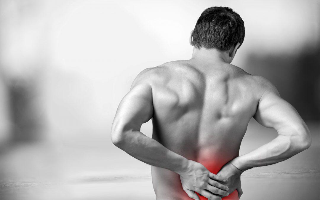 Lage rugpijn? Wat is het & wat kan je ertegen doen